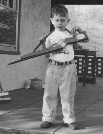 Frustration: Photo of J. Neil Schulman as a small child, crying while holding a toy rifle